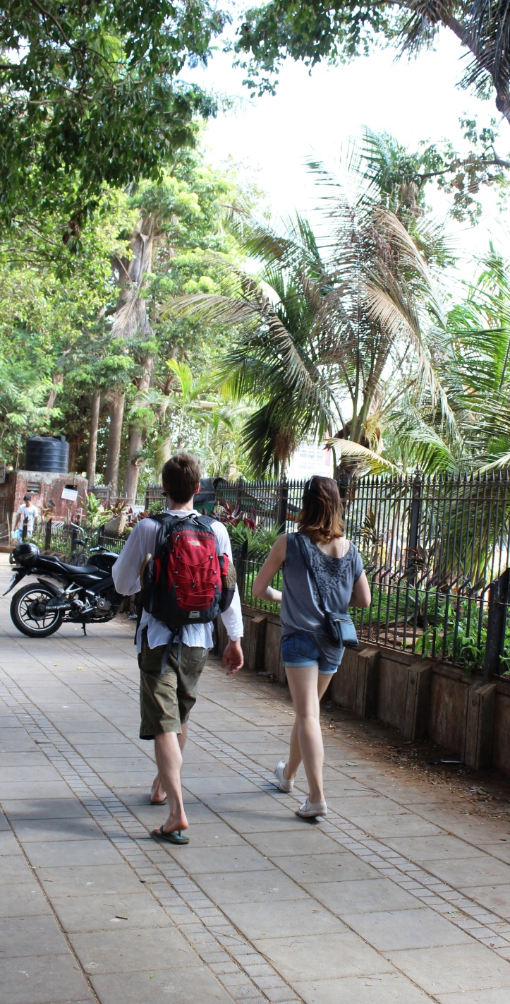 A tourist duo strolling next to Azad Maidan in South Mumbai - Photograph for Purchase at Shutterstock