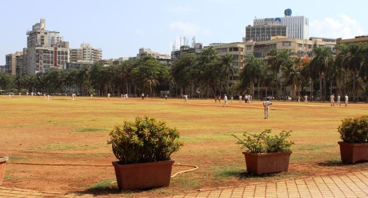 An on-going cricket match at Azad Maidan. Azad Maidan is a regular venue for inter-school cricket matches in Mumbai - Photograph for purchase at Shutterstock